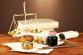 Wooden stamp, scales of justice and old papers on wooden table — Stock Photo