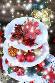 Christmas decorations on dessert stand, on wooden background — Stock Photo