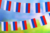Garland of flags on bright background — Stok fotoğraf
