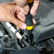 Hand with screwdriver. Auto mechanic in car repair — Stock Photo #37031007