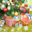 Decorated Christmas tree with gifts close-up — Stock Photo #37031085