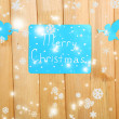 Stock Photo: Signboard with words Merry Christmas on wooden table background close-up