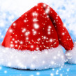 Christmas hat on table on light background — Stock Photo