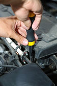 Hand with screwdriver. Auto mechanic in car repair — Stock Photo