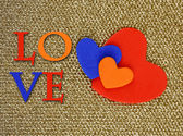 Hearts made of felt on golden background — Stock Photo