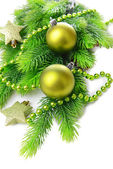 Christmas balls and decorative stars on fir tree, isolated on white — Stockfoto
