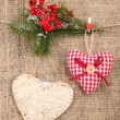 Stock Photo: Decorative hearts on rope, on burlap background