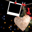 Decorative heart and empty photo paper on rope, on shiny background — Stock Photo