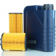 Stock Photo: Motor oil canister and filters isolated on white