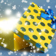 Gift box with bright light on it on blue background — Stock Photo #37077643