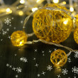 Stock Photo: Christmas decorative balls and garland, on wooden background