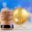 Stock Photo: Champagne cork on Christmas lights background