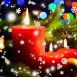 Composition with Burning candle, fir tree and Christmas decorations on multicolor lights background — Stock Photo #37078137