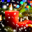 Composition with Burning candle, fir tree and Christmas decorations on multicolor lights background — Stock Photo