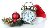 Alarm clock with Santa hat and Christmas decorations isolated on white — Stock Photo