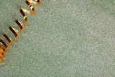 Golden ribbon on bright background — Stock Photo