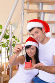Young couple celebrating New Years in new home on stairs background — Stok fotoğraf