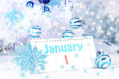 Calendar with New Year decorations on winter background — Stock Photo