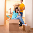 Young couple fooling around in new house on room background — Stock Photo #37097641