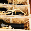 Wooden case with wine bottles close up — Stock Photo #37094451