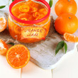 Orange jam with zest and tangerines, on white wooden table — Stock Photo #37094523