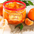 Orange jam with zest and tangerines, on white wooden table — Stock Photo #37094535