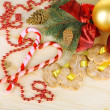 Stock Photo: Cookies on ribbons with Christmas decorations on wooden table