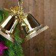 Bells with Christmas decoration on wooden background — Stock Photo