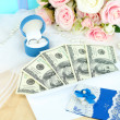 Dollar bills in envelope as gift at wedding on wooden table close-up — Stock Photo #37098509