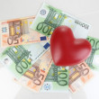 Stock Photo: Love for money concept. Heart on Europecurrency isolated on white