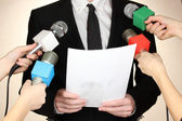 Conference meeting microphones and businessman — Stock Photo