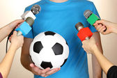 Conference meeting microphones and footballer — Stock Photo