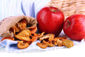 Dried apples and fresh apples, on napkin, on white wooden background — Foto de Stock
