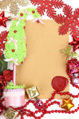 Frame with vintage paper and Christmas decorations close up — Zdjęcie stockowe