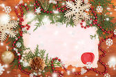 Frame with vintage paper and Christmas decorations on wooden background — Stock Photo