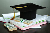 Money for graduation or training on wooden table on grey background — Stock Photo