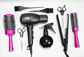 Hairdressing tools on silver background — Stock Photo