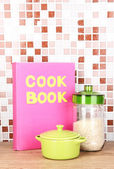 Culinary composition in kitchen on table on mosaic tiles background — Stock Photo