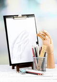 Sketch with professional art materials, on wooden table — Stock Photo