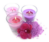 Beautiful colorful candles, orchid flower, sea salt isolated on white — Foto de Stock