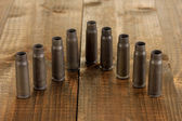 Shotgun cartridges on wooden table close-up — Stock Photo