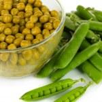 Green peas isolated on white — Stock Photo