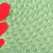 Hearts made of felt on green background — Stock Photo