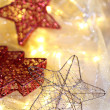 Christmas ornaments and garland on bright background close-up — Stock Photo #37105107