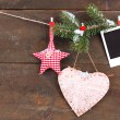Stock Photo: Decorative heart, star and empty photo paper on rope, on wooden background