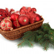 Christmas decorations in basket and spruce branches isolated on white — Stock Photo #37106975