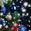 Toys on Christmas tree on Christmas lights background — Stock Photo