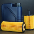 Motor oil canister on grey background — Stock Photo