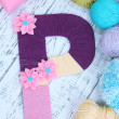 Stock Photo: One letter of knit handmade alphabet close up