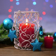 Candles and Christmas decoration on bright background — Stock Photo